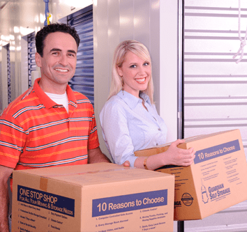 Couple Using Storage Unit