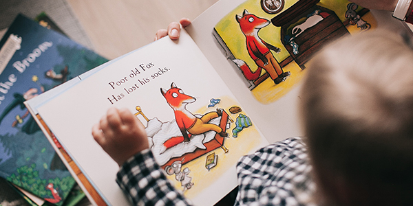 child reading a book about moving