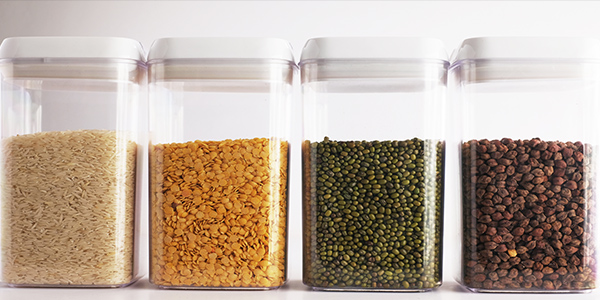 sealed containers with dried pasts and beans will help you with organizing your pantry.