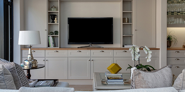 Utilize Shiny Surfaces Mirrors aren't the only things you can use in your room to add brightness. Shiny surfaces like chandeliers, silver, brass, metallics, or acrylic all reflect light. Décor like picture frames or lighting fixtures can be an easy way to add another shiny surface into your room. Simple, small additions of shiny surfaces here and there can easily bring additional light into the space.